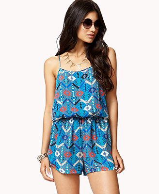 Girl with jumpsuit in a  stylish blue tribal pattern