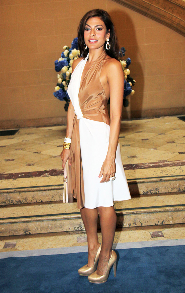 Eva Mendes in a beige and white dress