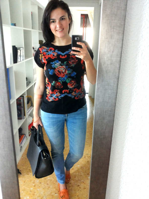 Floral t-shirt with blue jeans and orange shoes