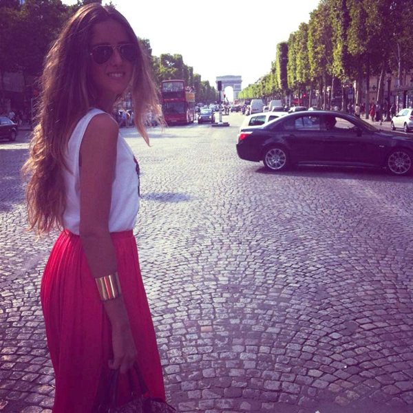 Wearing a red skirt and great sunglasses in Paris