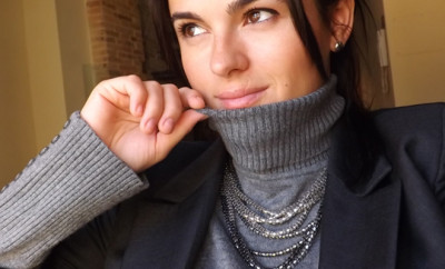 face-and-necklace-on-top-of-a-grey-sweater