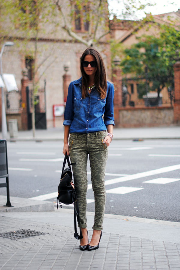 Camouflage pants and black leather heels