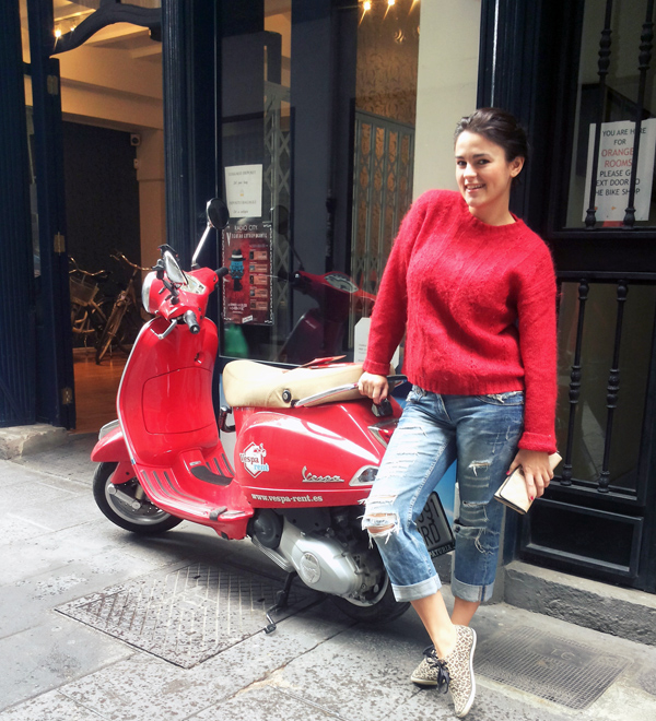 Red vespa with a girl in jeans and animal print