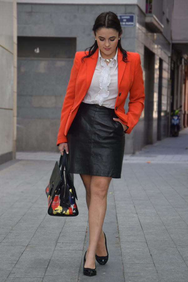 White shirt, leather skirt and orange blazer look to the office