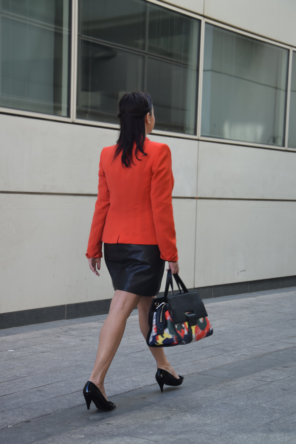 Orange blazer, white shirt and skirt for office attire