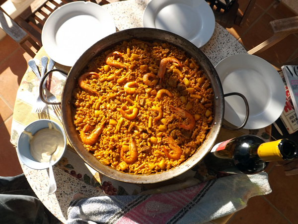 Paella and Spanish tourists in Spain