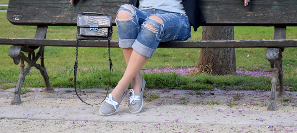 Girl in boyfriend jeans and running shoes