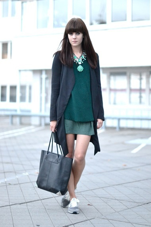 Model in green outfit and running shoes