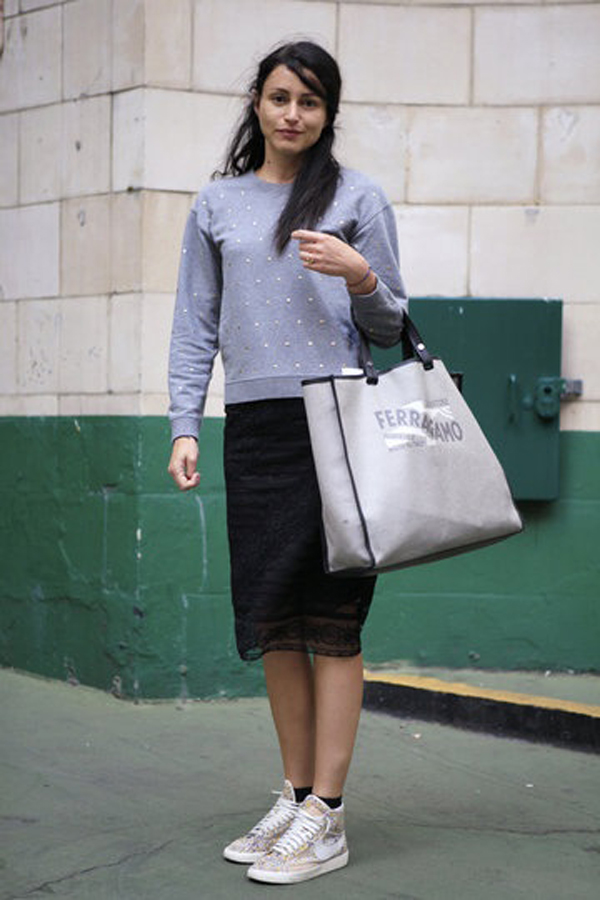 girl wearing nike-floral-pattern-shoes-and-black-skirt-grey-sweater-style advisor