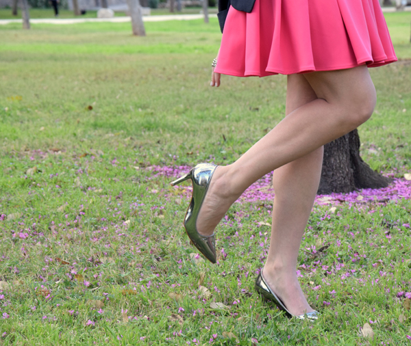 Close shot of silver shoes on a lawn  with pink flowers