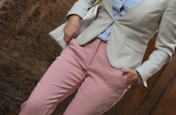 A girl walking in pink trousers from zara