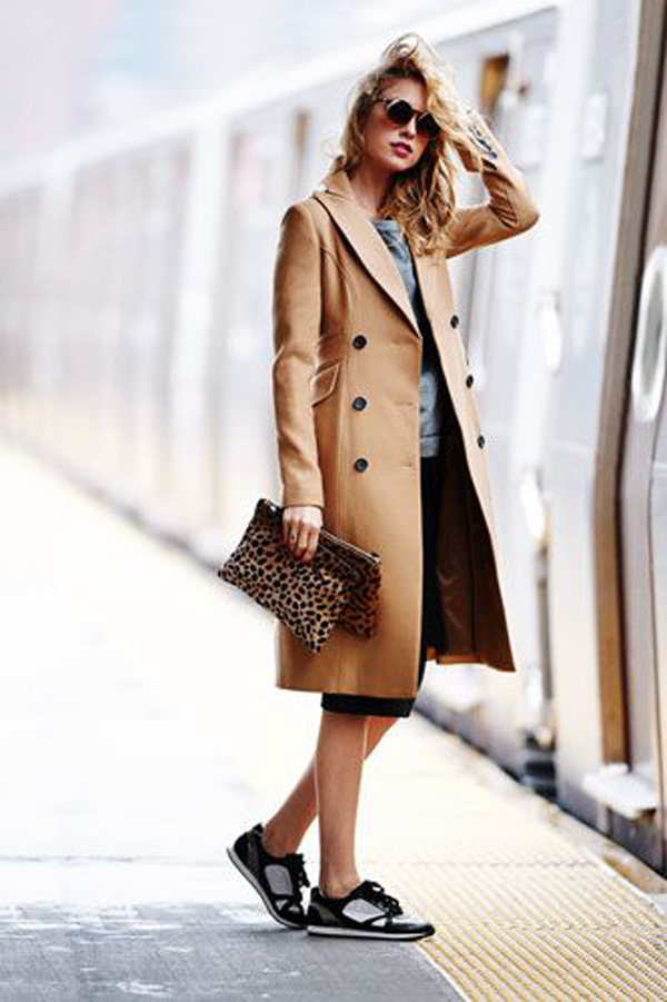 Model in sneakers and beige coat