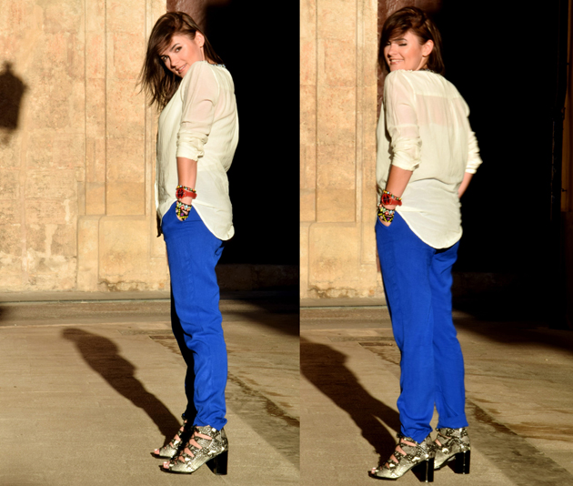 A lady in two outfits: White and blue