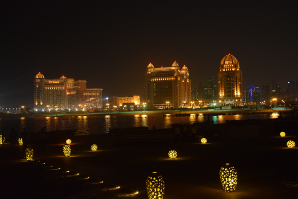 doha and katara by night with the city and lights