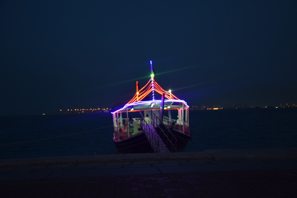 beach of qatar with a boat by night amazing view in qatar