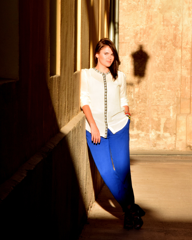 Style advisor in white and ethnic blue blouse