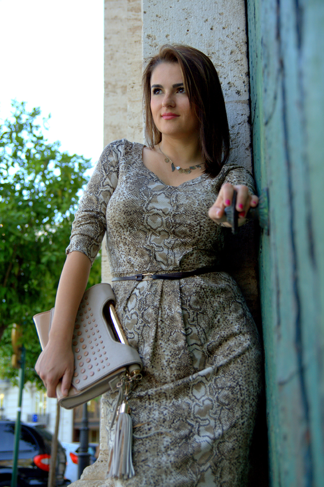 elegant woman dress smart casual in a classy dress with a bag in her hand