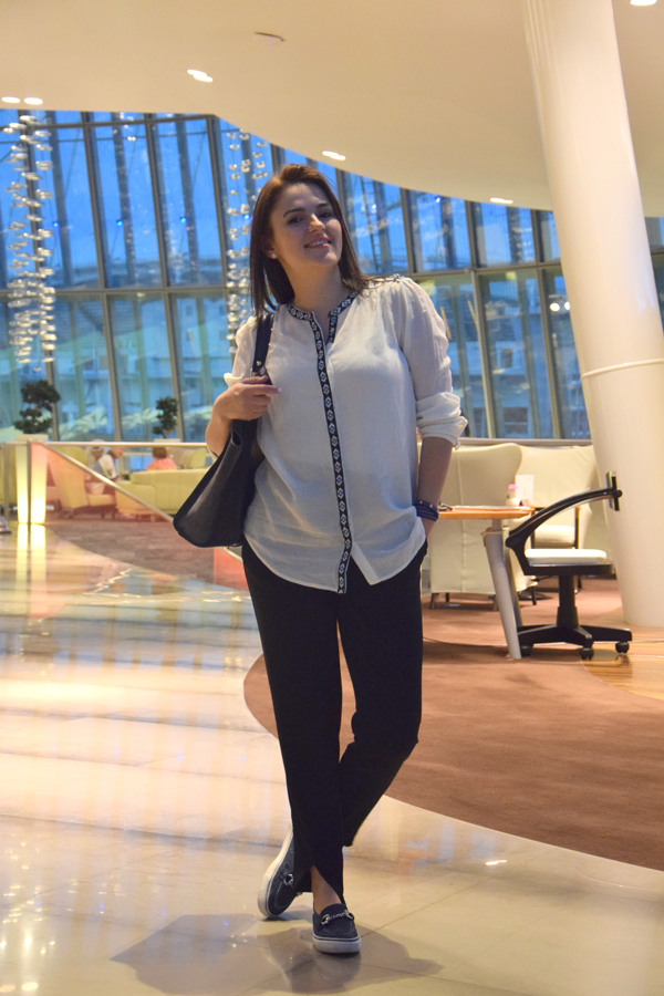 girl in white mango blouse and zara trousers in doha qatar