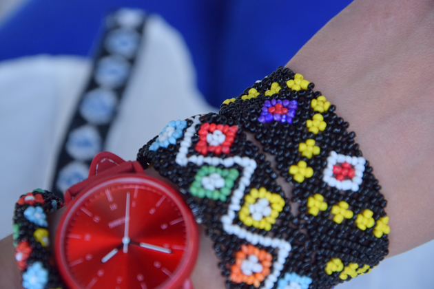 Hand with watch and Romanian handmade accessories