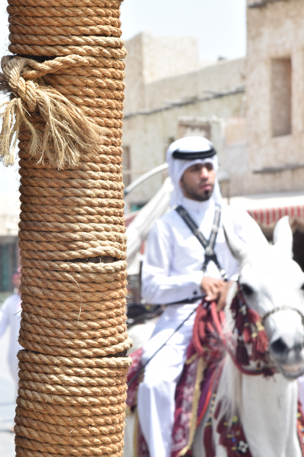local qatari in doha riding the horse in souk waqif