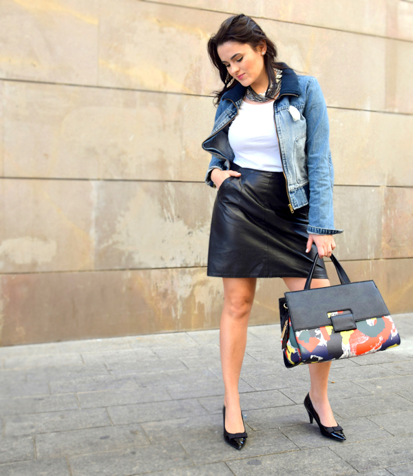 Woman in office outfit with leather skirt, deni jacket and elegant shoes