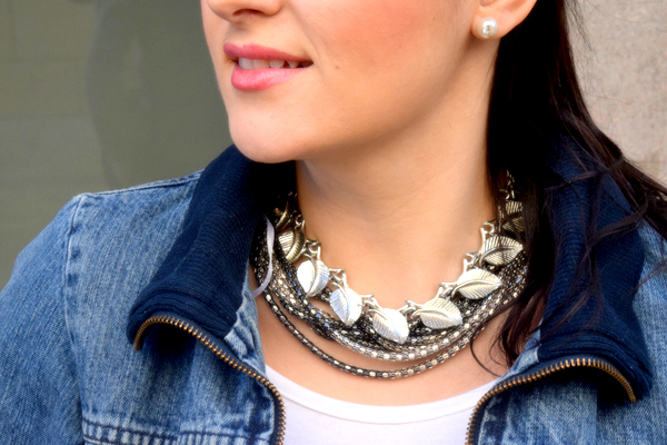 Girl wearing two silver necklaces and a denim jacket as a style advisor