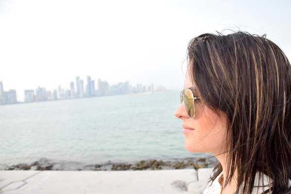 weatern woman in doha qatar, alcorniche with a beautiful view