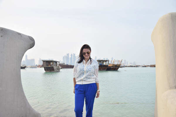 woman posing in al corniche in doha qatar wearing normal clothes