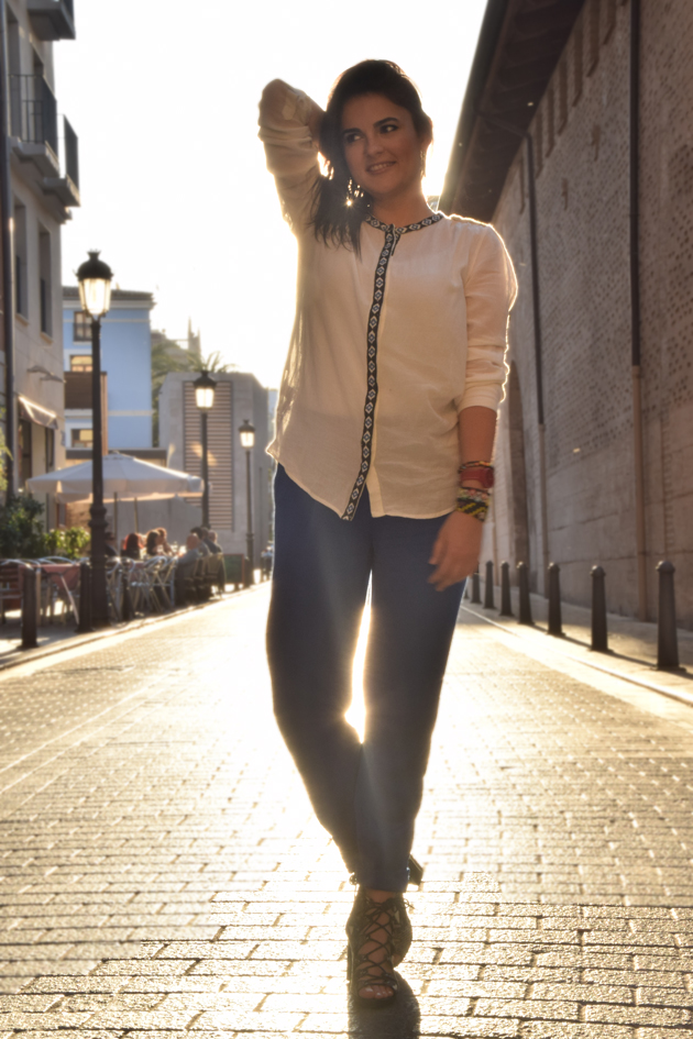 A girl in beautiful light wearing Chic clothes. She is a style advisor