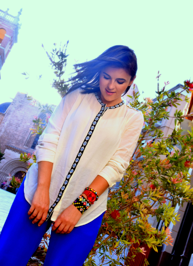 Beautiful girl wearing ethnic white blouse from Mango with H&M pants. She is the best fashion blogger