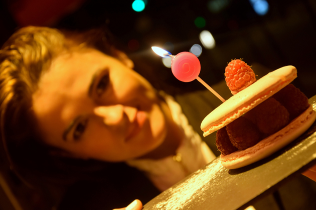 girl with a birthday cake made of macaroon