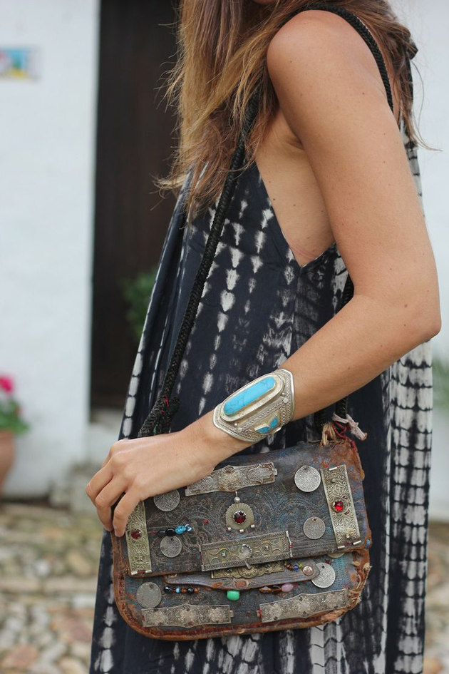 girl with a cool bracelet and a trendy handbag