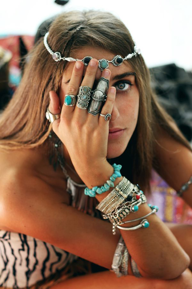 tanned woman with many earrings and bracelets in boho style