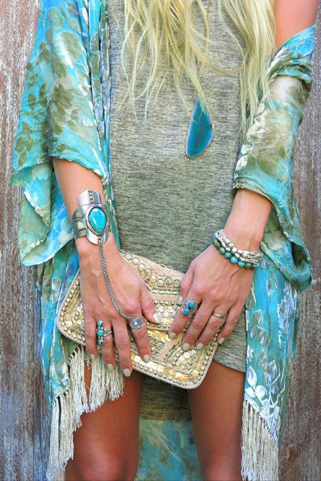 blonde girl in boho style with turquoise accessories for festival