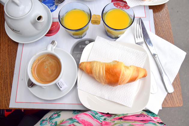 table with breakfast with croissant and coffee and orange juice in Paris