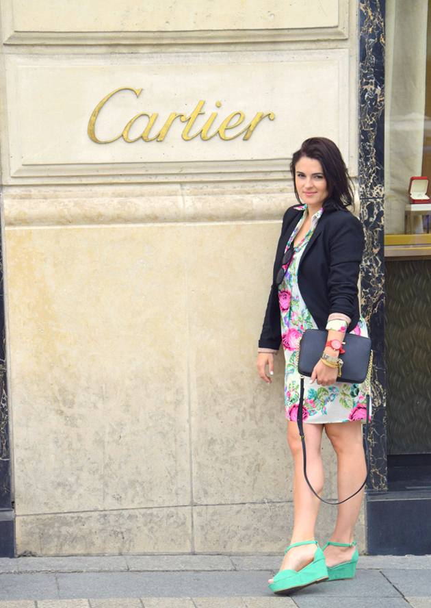 woman staying in front of Cartier store in Paris on Champs de Elysees