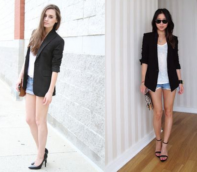 two elegant girls wearing high heels, denim shorts, a simple white tee and a black blazer