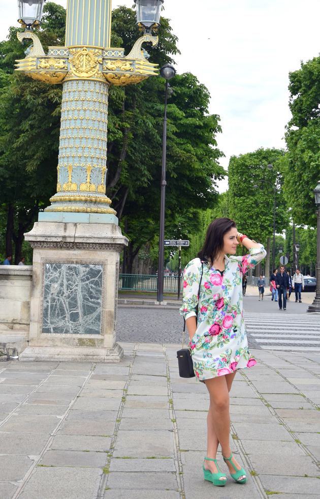 woman wearing a dress with a floral print in paris