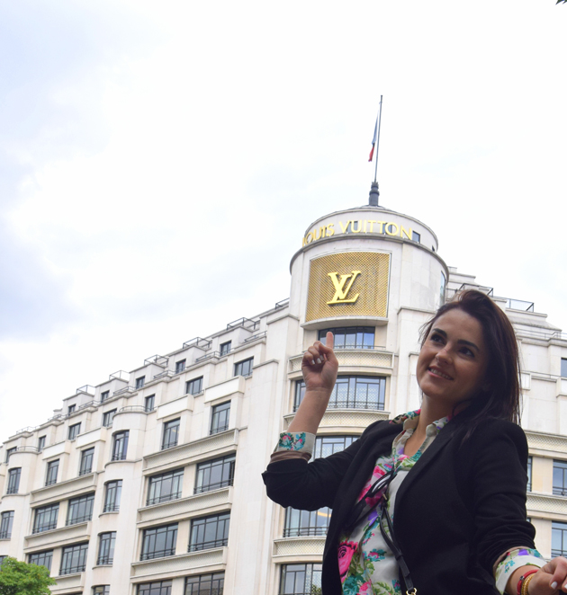 girl staying in front of Louis Vuitton store in Paris