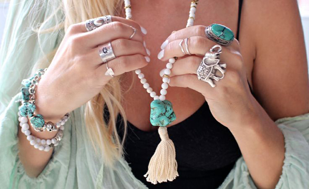 woman having a necklace with a turquoise stone in boho style