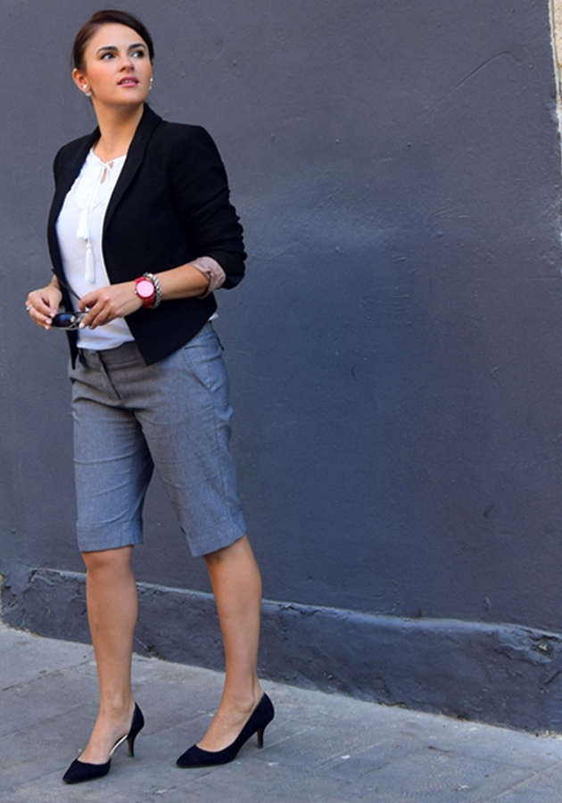 elegant woman wearing shorts to the office