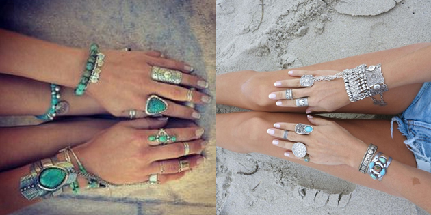 hands in the sand with many accessories for a hippie boho style