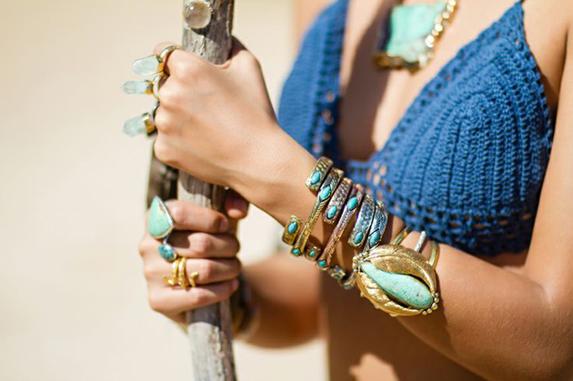 woman in a bra with many accessories in hippie style and turquoise