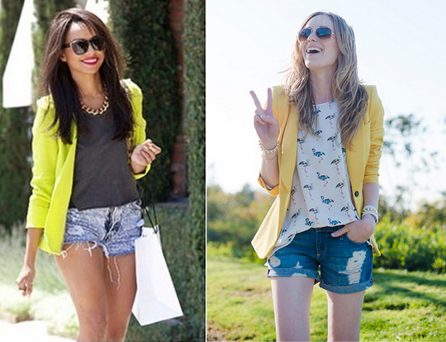 two happy smiling girls wearing chic yellow blazer and denim short pants