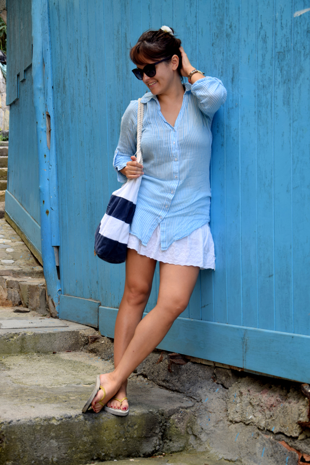girl in blue shirt and white skirt. She is Italy and she is wearing a casual and chic outfit