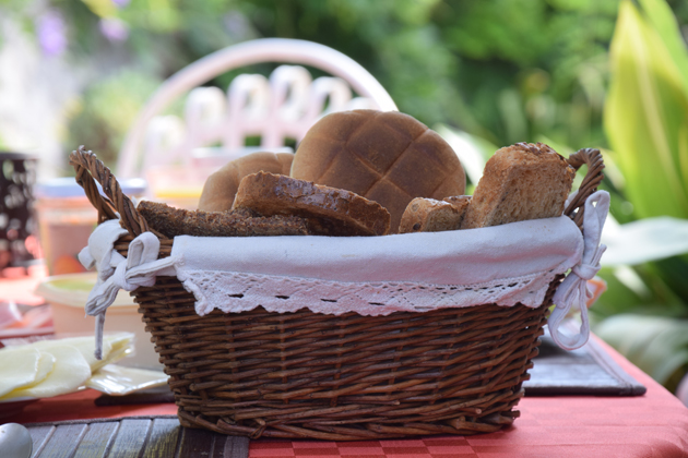 a basket with fresh bread amazing quality of photo