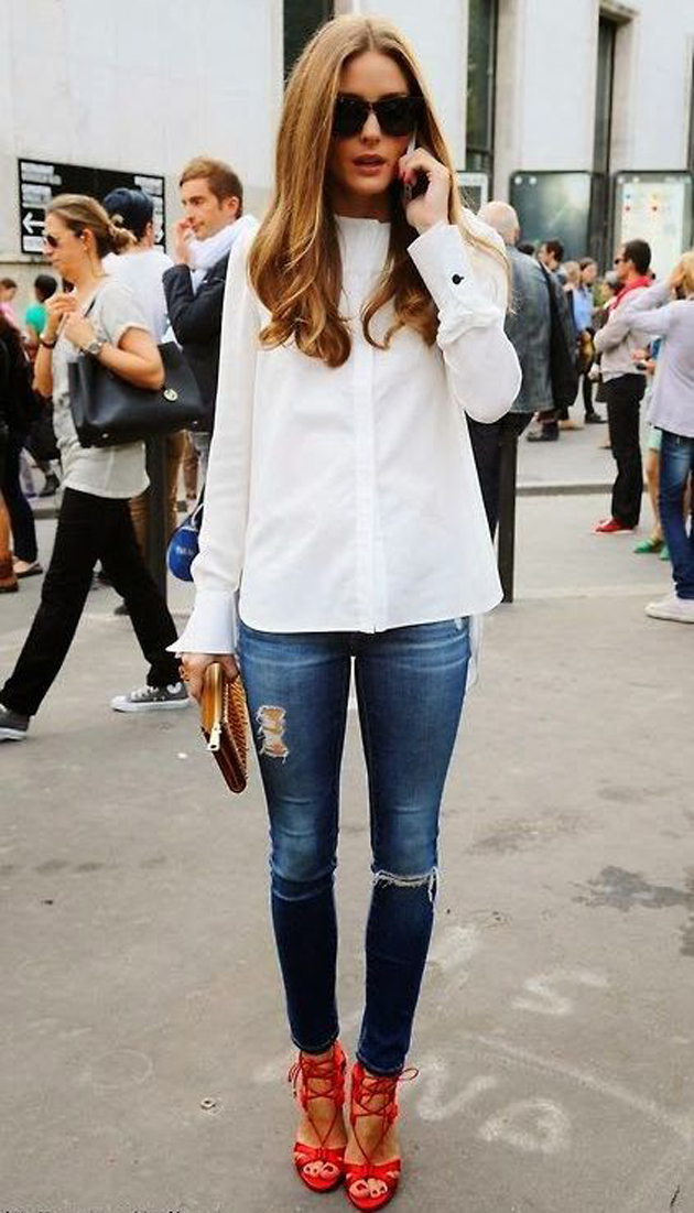 olivia palermo in red sandals. she is also wearing a white shirt and ripped jeans