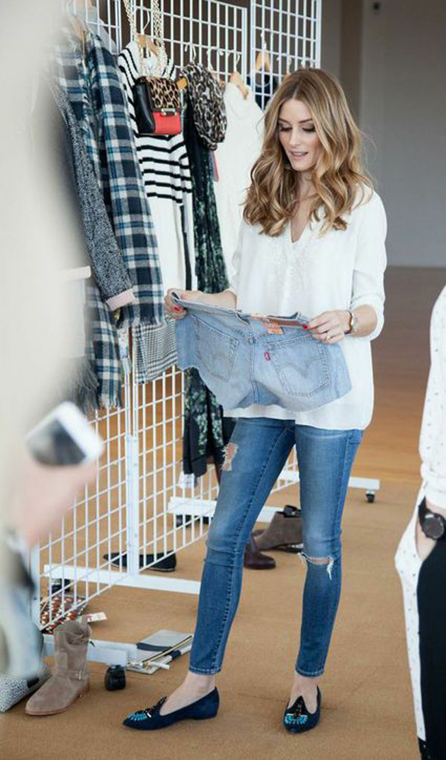 olivia palermo wearing white shirt and blue jeans. she is having her hair beautiful