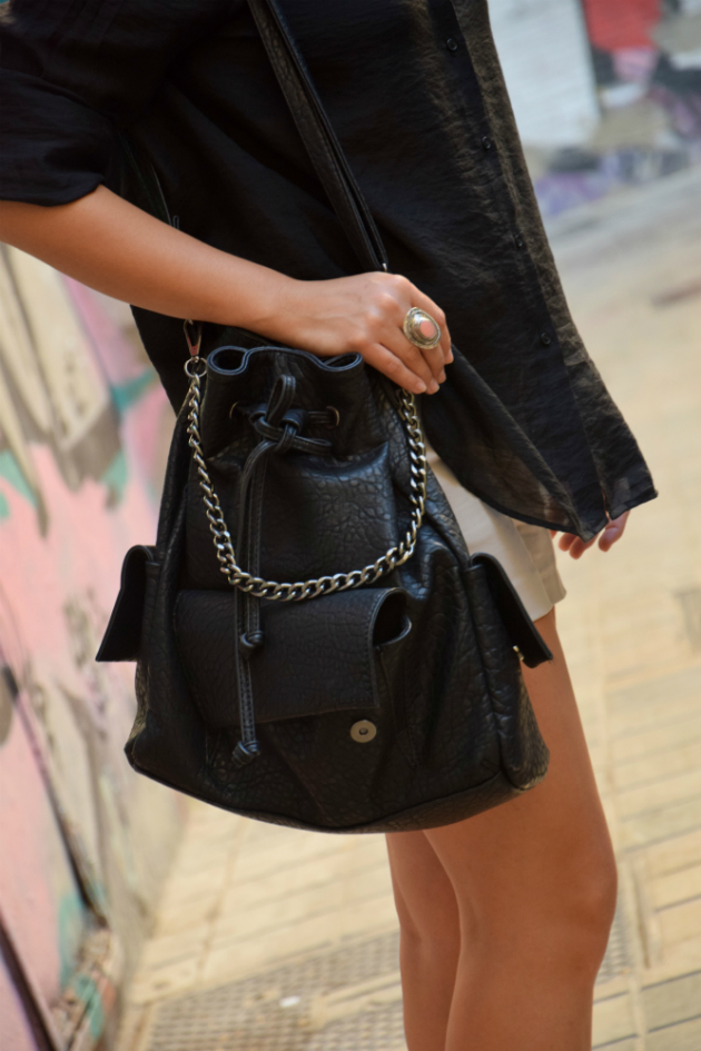 girl with a black handbag with chain