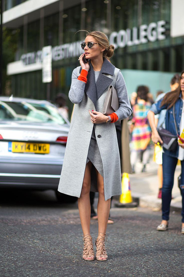 Olivia Palermo wearing grey dress and grey coat and beige sandals.